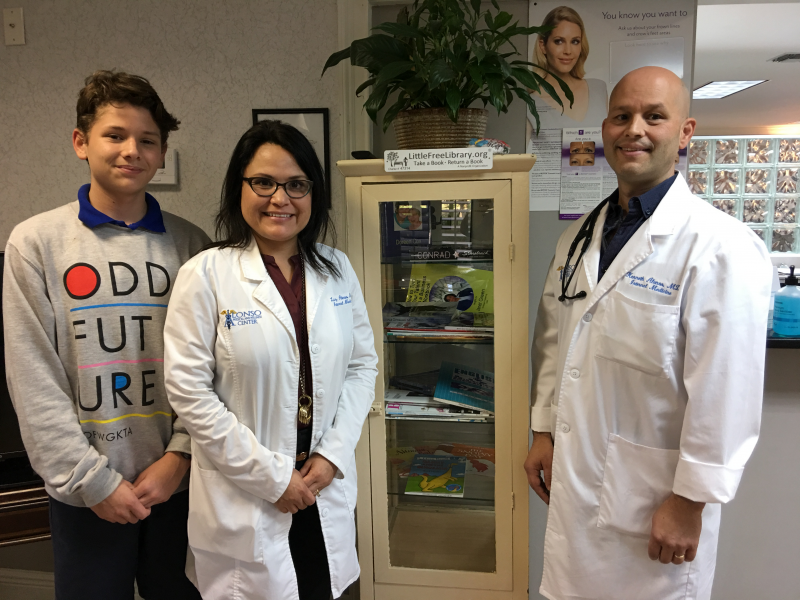 First Little Free Library in Forest City at Alonso Medical & Wellness--Kenneth, Rotarian Dr Luz, and Dr Ken Alonso