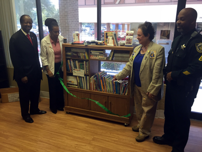 Third Little Free Library Ribbon Cutting in Pine Hills at Easy Access Women's Clinic--Rotarian Jennie Joseph, Midwife